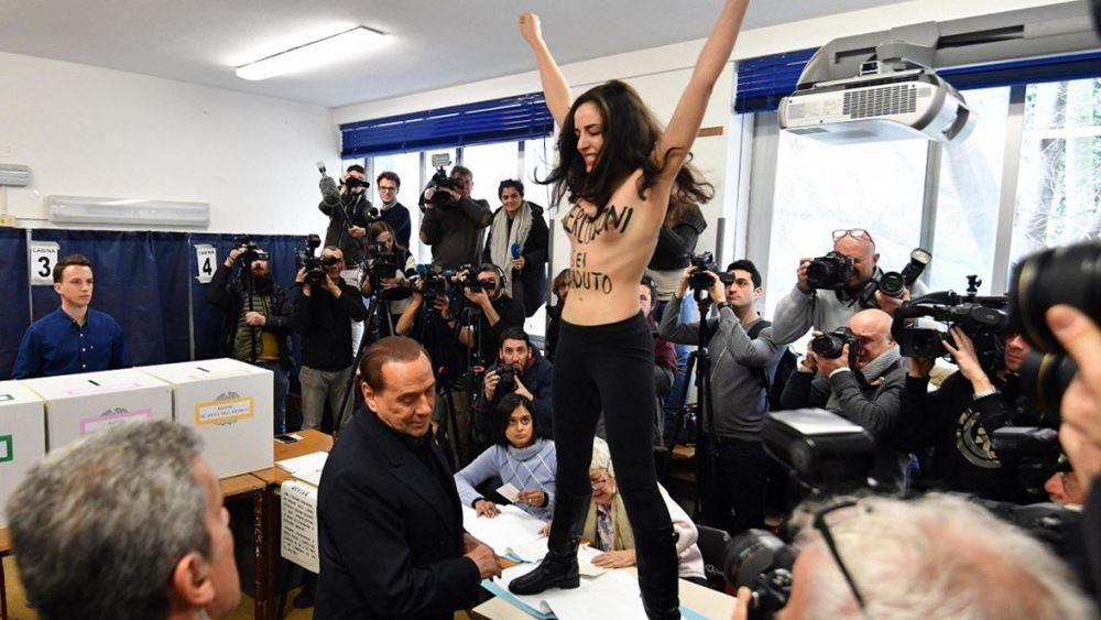 Ιταλία: Απρόοπτο για τον Σ. Μπερλουσκόνι με γυμνόστηθο μέλος των Femen ενώ ψήφιζε