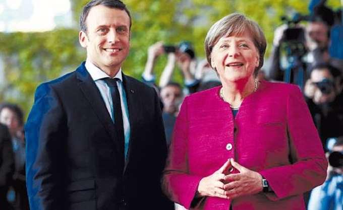 """Τον """"θαυμασμό"""" του για τη Μέρκελ και την """"αξιοπρεπή απόφασή"""" της, εκφράζει ο Μακρόν"""