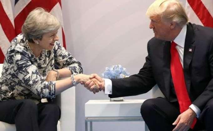 T. May: Ο Trump είναι αφοσιωμένος στο συμφέρον των ΗΠΑ