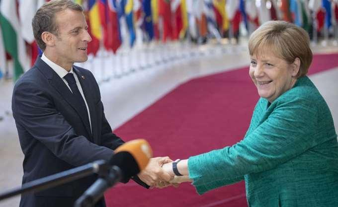 Επίδειξη ενότητας από τη Μέρκελ και τον Μακρόν 100 χρόνια μετά τον Α' Παγκόσμιο Πόλεμο