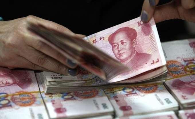 """Προς τριμηνιαίο """"ράλι"""" - ρεκόρ το κινεζικό γουάν έναντι του δολαρίου"""